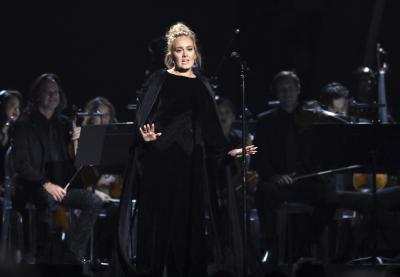 Adele performs a tribute to George Michael at the 59th annual Grammy Awards on Feb. 12, 2017, in Los Angeles. Adele says she gets some of her sparkle from an infusion of vitamins delivered through an IV. (Deseret Photo)