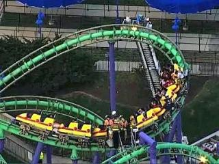 Authorities say 24 people are stuck in midair on a stalled roller coaster at an amusement park outside of Washington, D.C.
