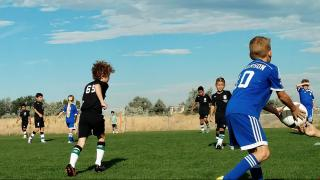 Should boys and girls compete against each other in organized team sports?