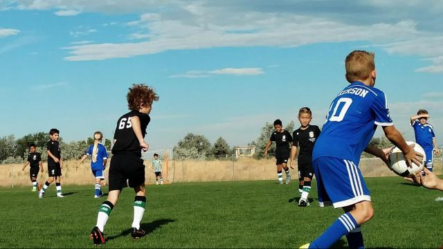 Arianne Brown's son (not pictured) plays in a game against a team with a female athlete (left). (Deseret Photo)