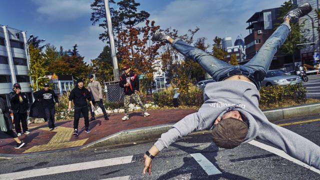 -- PHOTO MOVED IN ADVANCE AND NOT FOR USE - ONLINE OR IN PRINT - BEFORE DEC. 17, 2017. -- Kim Ki Su, a member of the Gamblerz crew who goes by Rocket, dances in the middle of the street as the crew waits to cross in Seoul, Nov. 6, 2017. Seoul's B-boys have borrowed much more than music from American hip-hop. (An Rong Xu/The New York Times)