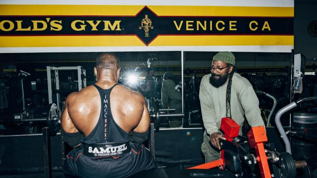 Charles Glass works with bodybuilder Silvio Samuel during a session at Gold's Gym in Venice Beach, Calif., Nov. 28, 2017. Glass, a bespectacled, beanie-wearing and dreadlocked former bodybuilding champion, has trained numerous celebrities, and YouTube and Instagram have turned him into something of a national fitness celebrity. (Graham Walzer/The New York Times)
