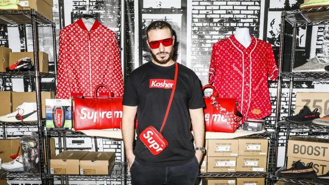 """Bryan Cohen of Kosher, at his style """"museum"""" with limited-edition pieces from the Supreme and Louis Vuitton collaboration at Sneaker Con at the Jacob K. Javits Convention Center in New York, Dec. 16, 2017. Sneaker Con, a gathering of shoe fanatics founded in 2009, brought 500 vendors and over 19,000 people to the Javits Convention Center in New York. (Krista Schlueter/The New York Times)"""