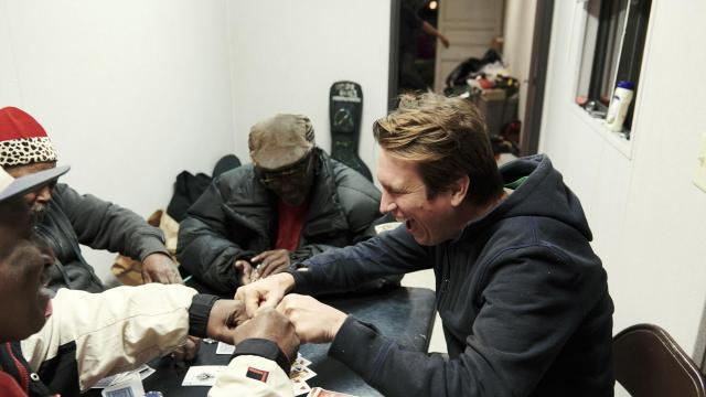 "Pete Holmes, the actor and comedian, plays a hand of poker with the operators of a Christmas tree lot in Los Angeles, Dec. 5, 2017. Holmes, who writes and stars in the HBO series ""Crashing,"" says his spiritual side has helped him cope in Hollywood. ""The pitfall of buying and believing your own hype is a deep, echoing, wet, cold sadness,"" he said. (Jake Michaels/The New York Times)"