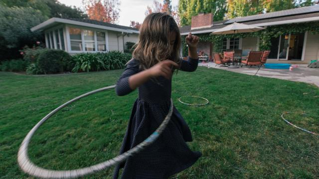 """One of Kristin Stetcher's daughters, who she said have no screen time """"budget,"""" plays in their backyard in Menlo Park, Calif., Oct. 26, 2018. A wariness that has been slowly brewing is turning into a regionwide consensus: The benefits of screens as a learning tool are overblown. (Peter Prato/The New York Times)"""