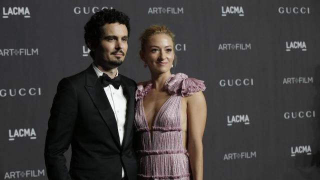 """Damien Chazelle, the director of """"First Man,"""" with his wife, Olivia Hamilton during the Art & Film Gala for the Los Angeles County Museum of Art, Nov. 3, 2018. The annual gala, a high point of the Los Angeles fall social calendar, brought together Hollywood directors, actors and artists. (Elizabeth Lippman/The New York Times)"""