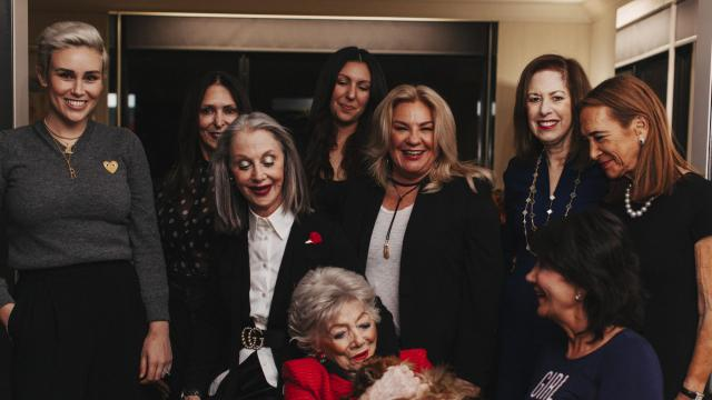 PHOTO MOVED IN ADVANCE AND NOT FOR USE - ONLINE OR IN PRINT - BEFORE NOV. 11, 2018. -- Left to right, Noe Mor, Laurie Mertz, Susan Good, Danielle Ward, Colette Green, Kay Torshen, Betty Bronner, Maria Pappas and Elaine Lang with America during a gathering at Good's apartment, in Chicago, Sept. 26, 2018. Good has started a private social network where women can share their stories, concerns and triumphs, not just with people in their age group, but across generations. (Danielle Scruggs/The New York Times)