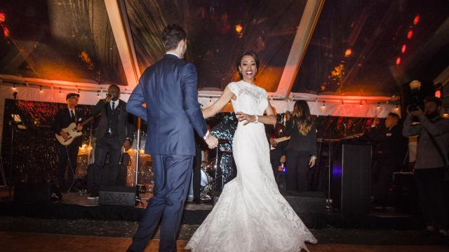 Newlyweds Dottie Cannon and Konrad Bieniek on the reception dance floor in New Hampton, N.Y., Oct. 6, 2018. Cannon, a Miss USA contestant who had a free lifetime membership to Match.com after appearing in a company commercial in 2012; it took 70 dates before the stars aligned. (Lauren Lancaster/The New York Times)