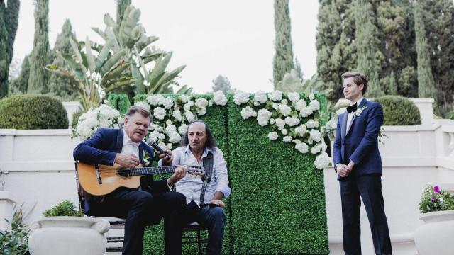 "Jeff Rohrer, left, a former NFL player, performs a song he wrote about Joshua Ross, right, during their wedding ceremony in Los Angeles, Nov. 18, 2018. Rohrer, a former Dallas Cowboys linebacker, became the first known NFL player, past or present, to marry a man when he wed Ross, a 36-year-old aesthetician, at the Wattles Mansion Gardens. ""This wedding broke down walls,"" Rohrer said. (Alex Welsh/The New York Times)"