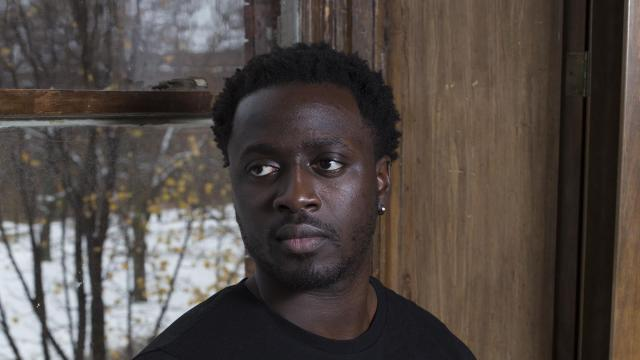 """Nana Kwame Adjei-Brenyah, the author of """"Friday Black,"""" in Syracuse, N.Y., Nov. 16, 2018. Kwame Adjei-Brenyah says he can adapt his look to play up or tamp down his blackness. (Courtney Asztalos/The New York Times)"""