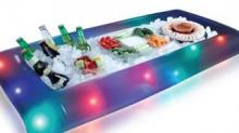 IMAGE: This Light-Up Buffet Cooler Pool Float Is Ridiculously Perfect For Summer Parties