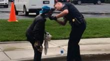 IMAGE: A Police Officer Helped A Homeless Man Struggling To Shave