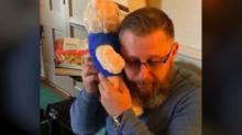 IMAGE: Dad Listens To Late Son's Heartbeat In Teddy Bear
