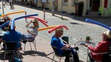 IMAGE: A Cafe Is Creatively Using Pool Noodles To Keep Customers Socially Distanced