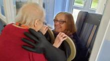 IMAGE: Nursing Home Created 'hugging Mitts' So Families Can Safely Interact During The Pandemic