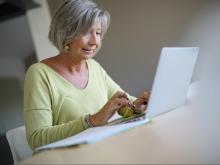 Senior woman at home using laptop computer