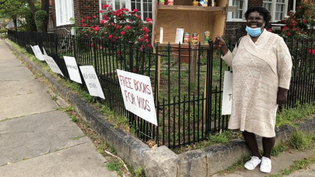 Residents of New Bern House share food, books and inspirational messages with passers-by during the pandemic