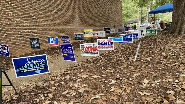 Campaign signs line the walkway into the community center