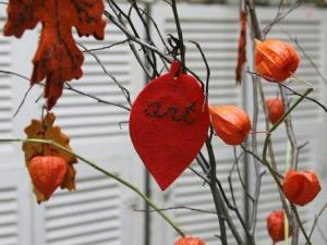 """An embroidered felt leaf hangs on a """"Thankful Tree"""" at the Brooklyn General Store, in the Brooklyn borough of New York, Tuesday, Oct. 23, 2007. (AP Photo/Hillary Rhodes)"""