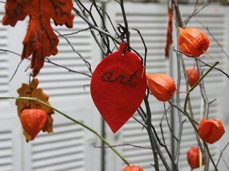 "An embroidered felt leaf hangs on a ""Thankful Tree"" at the Brooklyn General Store, in the Brooklyn borough of New York, Tuesday, Oct. 23, 2007. (AP Photo/Hillary Rhodes)"