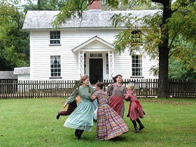 Children dressed in period clothes play at Duke Homestead in Durham. (Photo courtesy of N.C. Department of Cultural Resources)