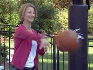 Ellen Schwartz plays basketball with her son outside their Raleigh home. Even as a stay-at-home mom, she says she feels pressure to be a perfect parent.