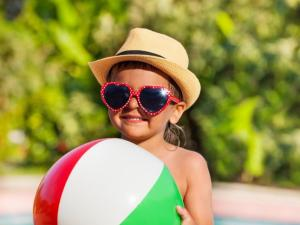 Summer is here and kids are out of school for summer break. While you are enjoying the sun, taking precautions to protect your kids from the harmful rays will pose some long-term benefits. (Deseret Photo)
