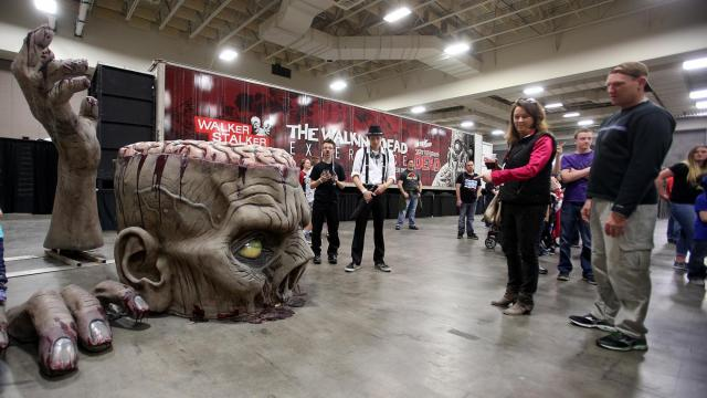 Comic Con attendees stand outside The Walking Dead Experience in Salt Lake Comic Con Fan X at the Salt Palace Convention Center in Salt Lake City, Friday, March 25, 2016. (Deseret Photo)