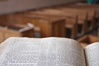 A bible in a church pulpit overlooking the church (Adobe) (Deseret Photo)