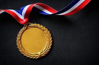 Gold medal on black with blank face for text, concept for winning or success (Deseret Photo)