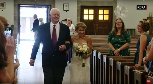 A bride is escorted down the aisle by her deceased father's heart recipient. (Deseret Photo)