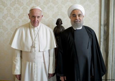 Pope Francis poses with Iranian President Hassan Rouhani at the Vatican, Tuesday, Jan. 26, 2016. Pope Francis held talks with the Iranian president Tuesday, and the Vatican said Tehran was called on to combat terrorism, now that the nuclear accord is bringing Iran a bigger role in regional conflicts. (AP Photo/L'Osservatore Romano/Pool Photo via AP) (Deseret Photo)