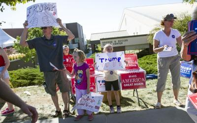 David Wald campaigns with his daughters Tessa and Catherine in support of presidential candidate Donald Trump at a rally before the Utah and BYU rivalry game in Salt Lake City on Saturday, Sept. 10, 2016. (Deseret Photo)