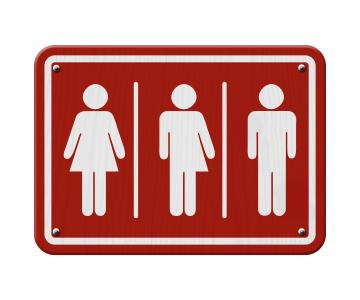 Red and white sign includes woman, male and transgender symbols. (Deseret Photo)