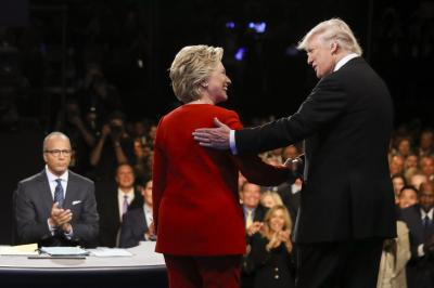 In this Sept. 26, 2016, file photo, Democratic presidential nominee Hillary Clinton and Republican presidential nominee Donald Trump shake hands during the presidential debate at Hofstra University in Hempstead, N.Y. (Deseret Photo)