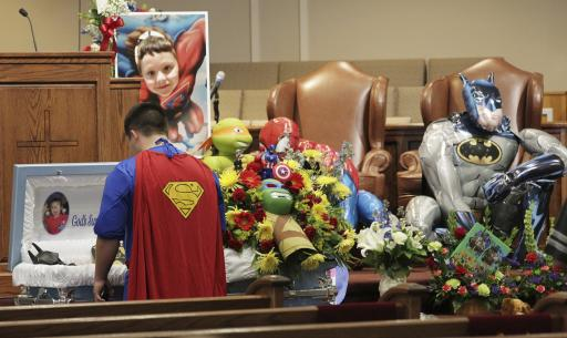 Dale Hall, dressed as Superman, stands before the casket during a superhero-themed funeral service for his brother, Jacob Hall at Oakdale Baptist Church on Wednesday, Oct. 5, 2016, in Townville, S.C.  A 14-year-old boy killed his own father, then drove to Townville Elementary and fired on two children and a teacher as recess began.  Jacob died Saturday. (Ken Ruinard/The Independent-Mail via AP, Pool) (Deseret Photo)