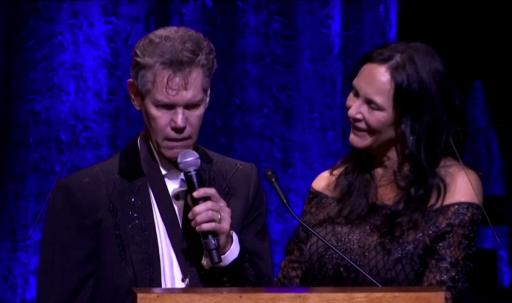 "Randy Travis sings ""Amazing Grace"" with his wife, Mary Davis Travis, at the Country Music Hall of Fame induction ceremony on Sunday. (Deseret Photo)"