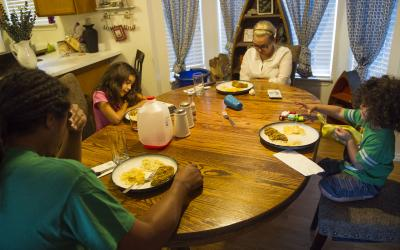 Maasi says prayers before the Tuatonga family eats supper at their home in West Valley City on Thursday, Oct. 6, 2016. (Deseret Photo)
