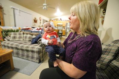 Sharon Miller holds her granddaughter Jordyn Caddle at home in Magna Tuesday, Nov. 10, 2015. (Deseret Photo)