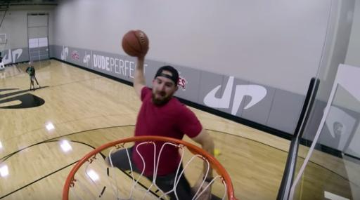Dude Perfect's Tyler Toney goes up for a trampoline alley-oop. (Deseret Photo)