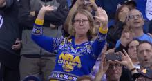 IMAGE: The Clean Cut: Middle-aged woman busts a move at NBA game