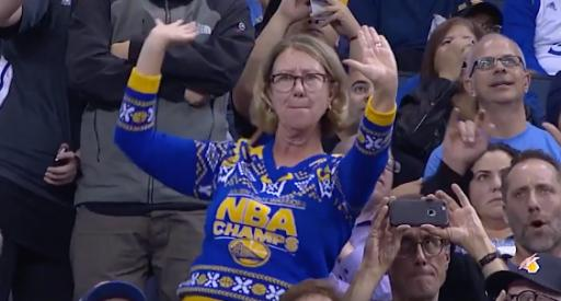 A woman at a Golden State Warriors home game busts a move during a timeout. (Deseret Photo)