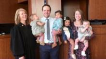 IMAGE: Childless couple becomes parents of 4 overnight