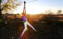 Lily Johnson rides the zip line at her grandfather Lynn Johnson's home in Draper Utah, on Monday, Nov. 7, 2016. (Deseret Photo)