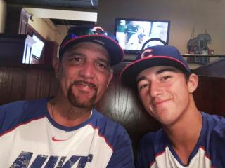 Josh Jaime and his son, Solomon, 17, have dinner at Rosie O'Grady's, a restaurant near their home of Novi, Michigan, while they watch a Cubs baseball game. (Deseret Photo)