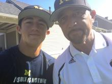 "Josh Jaime and his son, Solomon, 17, at ""The Big House in Ann Arbor"" - a nickname for Michigan Stadium, where Solomon's favorite college football team, the Michigan Wolverines, play. (Deseret Photo)"