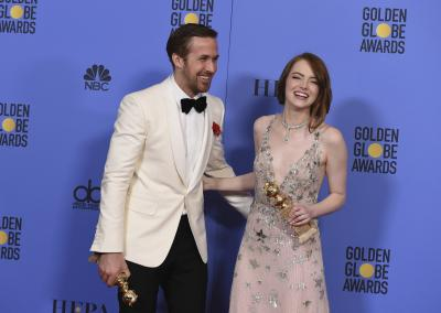 "Ryan Gosling, left, and Emma Stone pose in the press room with the award for best performance by an actor and actress in a motion picture - musical or comedy for ""La La Land"" at the 74th annual Golden Globe Awards at the Beverly Hilton Hotel on Sunday, Jan. 8, 2017, in Beverly Hills, Calif. (Photo by Jordan Strauss/Invision/AP) (Deseret Photo)"