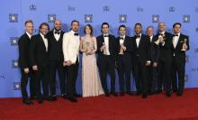"The cast and crew of ""La La Land"" poses in the press room with the award for best motion picture - musical or comedy at the 74th annual Golden Globe Awards at the Beverly Hilton Hotel on Sunday, Jan. 8, 2017, in Beverly Hills, Calif. (Photo by Jordan Strauss/Invision/AP) (Deseret Photo)"
