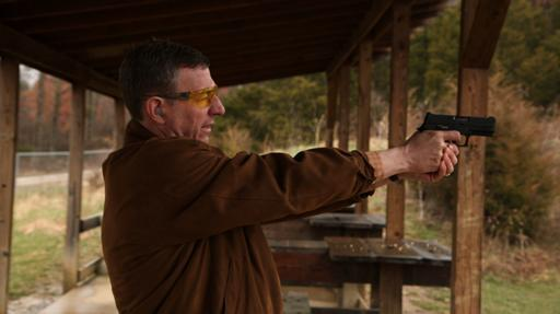 """Rev. Rob Schenck at a gun range to try to understand a different side of the gun violence issue, as portrayed in the documentary """"The Armor of Light."""" (Deseret Photo)"""