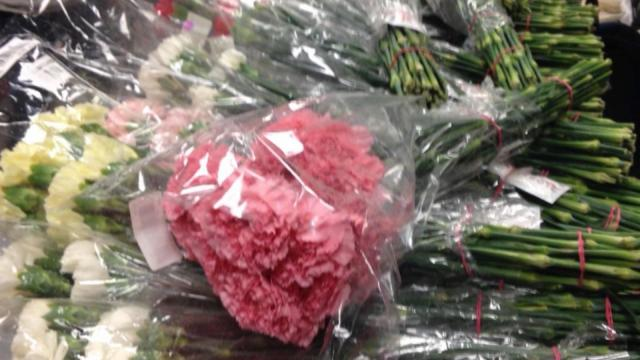 Some of the carnations Hayden Godfrey bought for his female classmates at Sky View High School for Valentine's Day are pictures on Thursday, Feb. 11, 2016. (Deseret Photo)